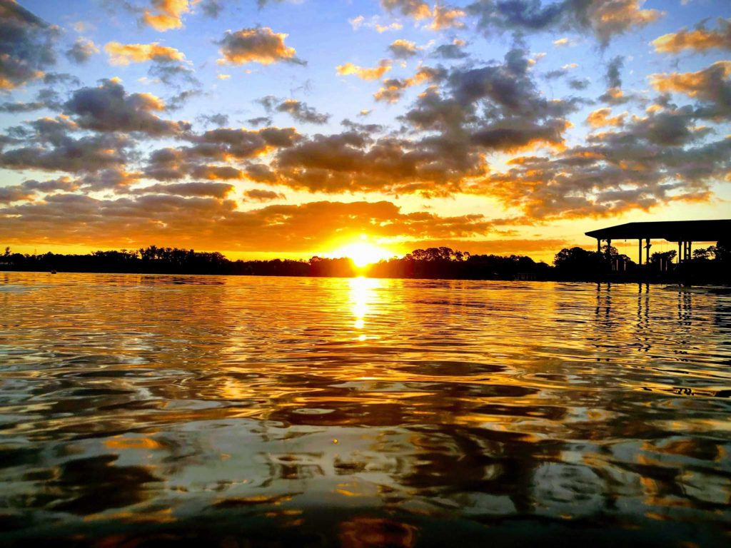 Glorious Sunrise over a lake by Audrey Carter