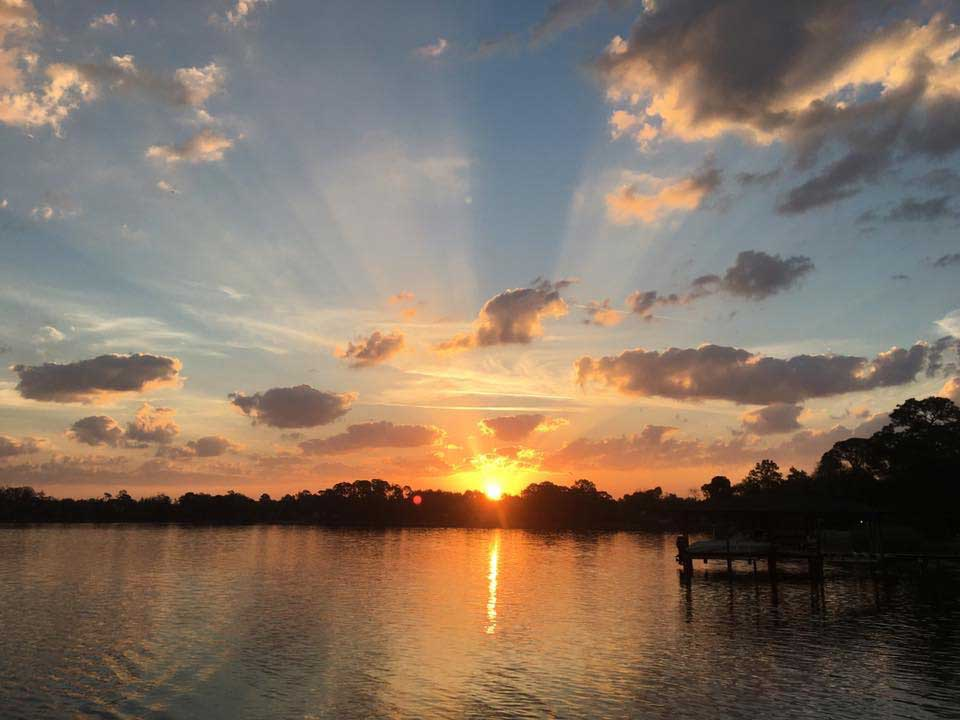 Anti-Crepuscalar rays over lake by Audrey Carter